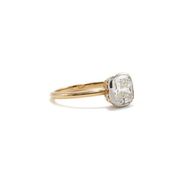 gold band and cushion cut engagement ring