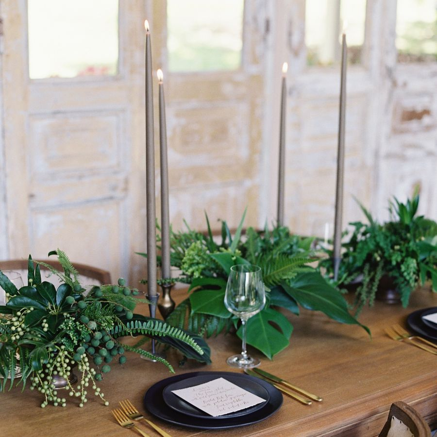 Thin grey candles on wooden table