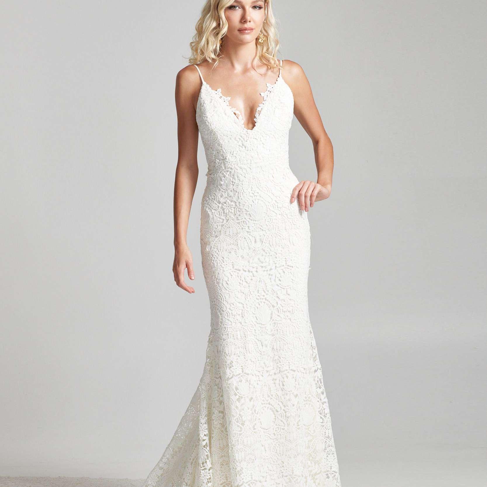 Model in spaghetti strap V-neck lace column wedding dress