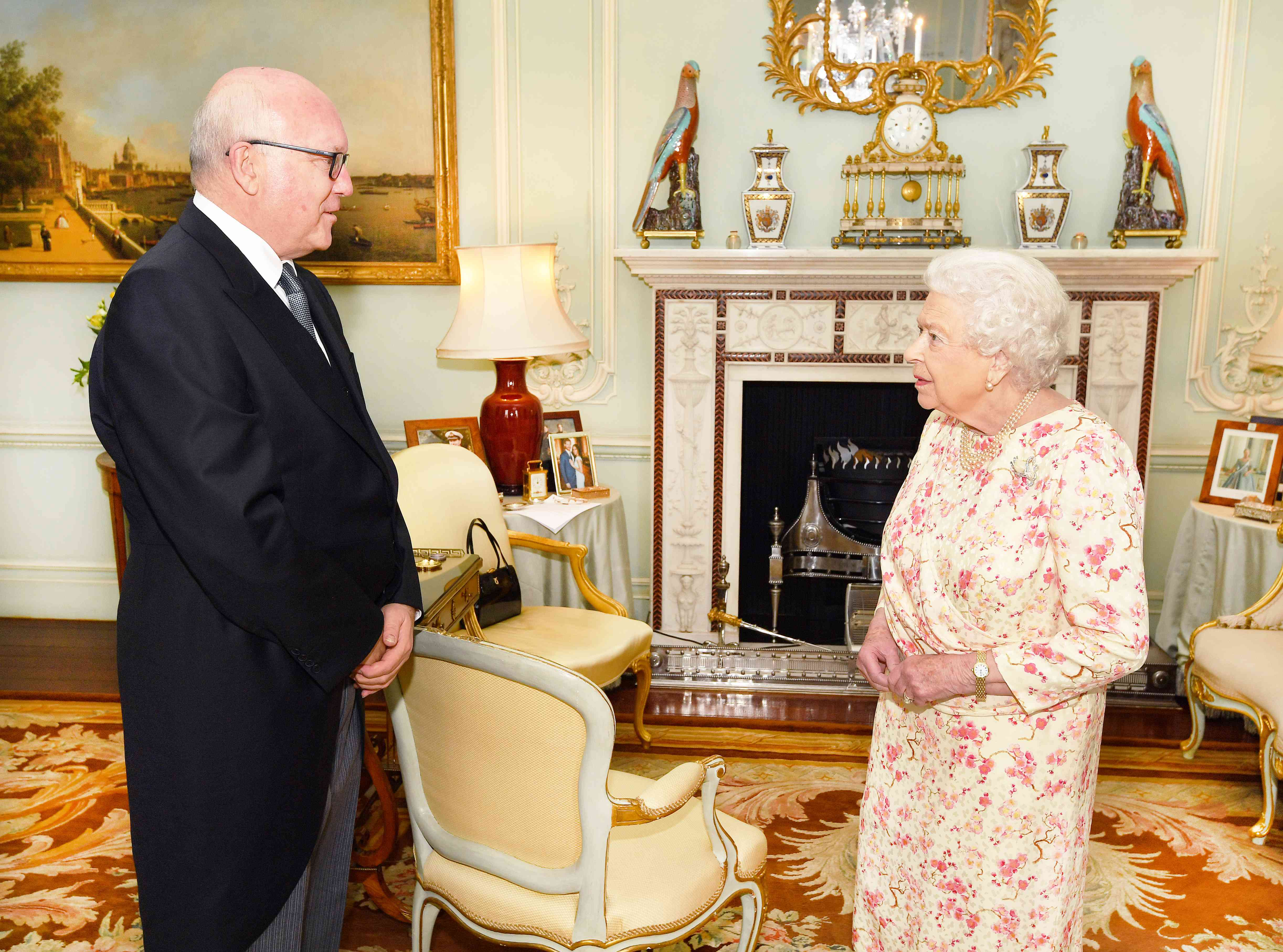 Queen Elizabeth II talks with the Honorable George Brandis, the Australian High Commissioner to the United Kingdom