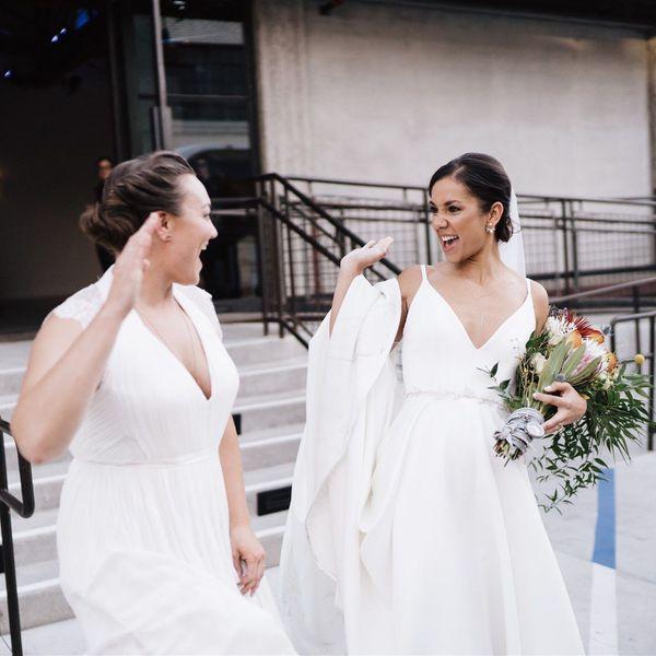 brides high-fiving