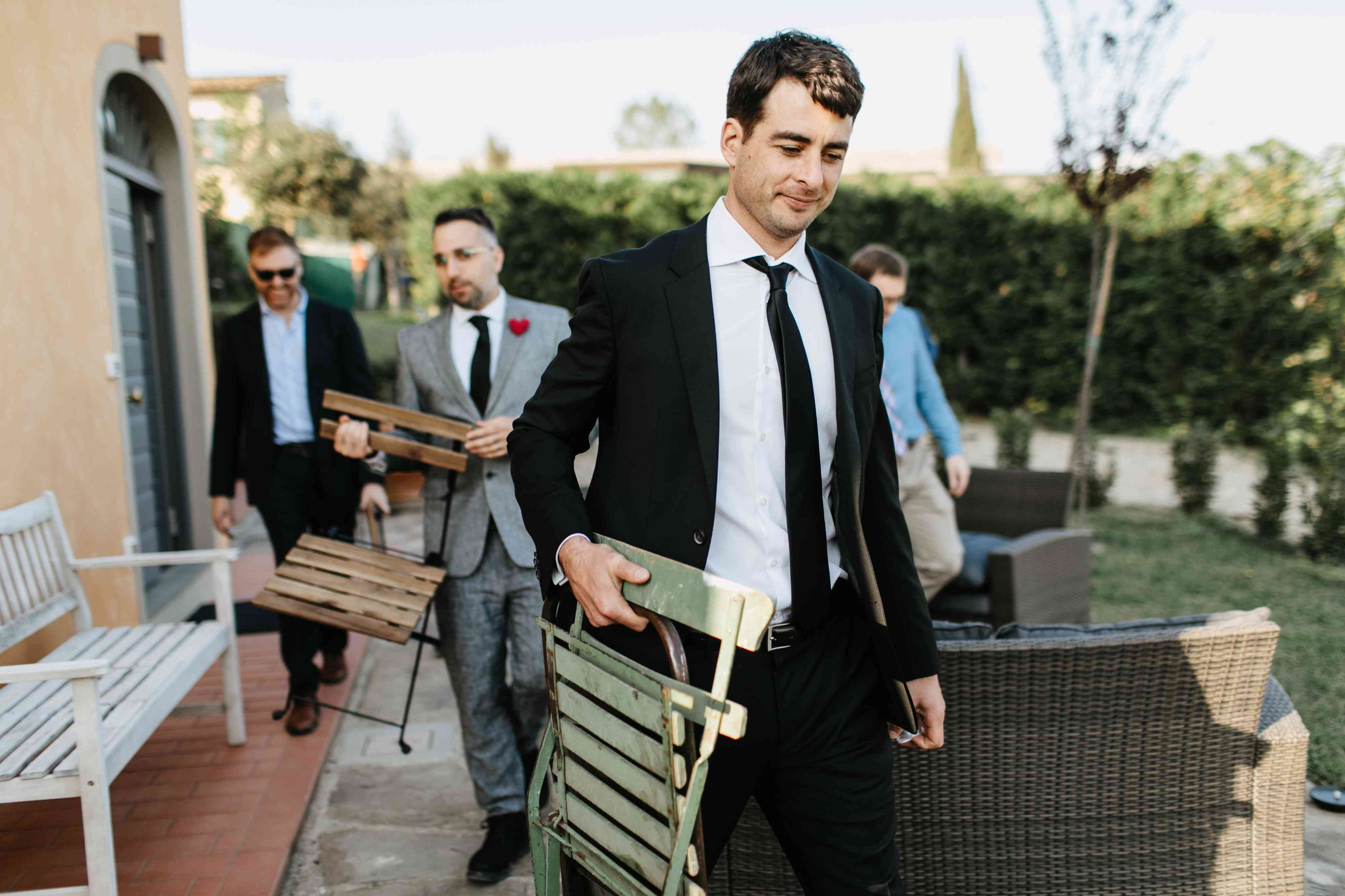 <p>wedding guests carrying wedding chairs</p><br><br>