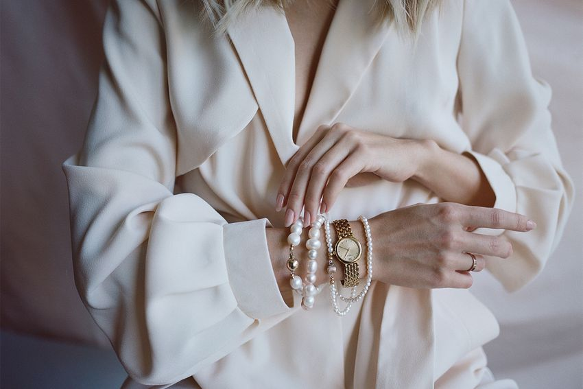Girl's hands with pearl jewelry