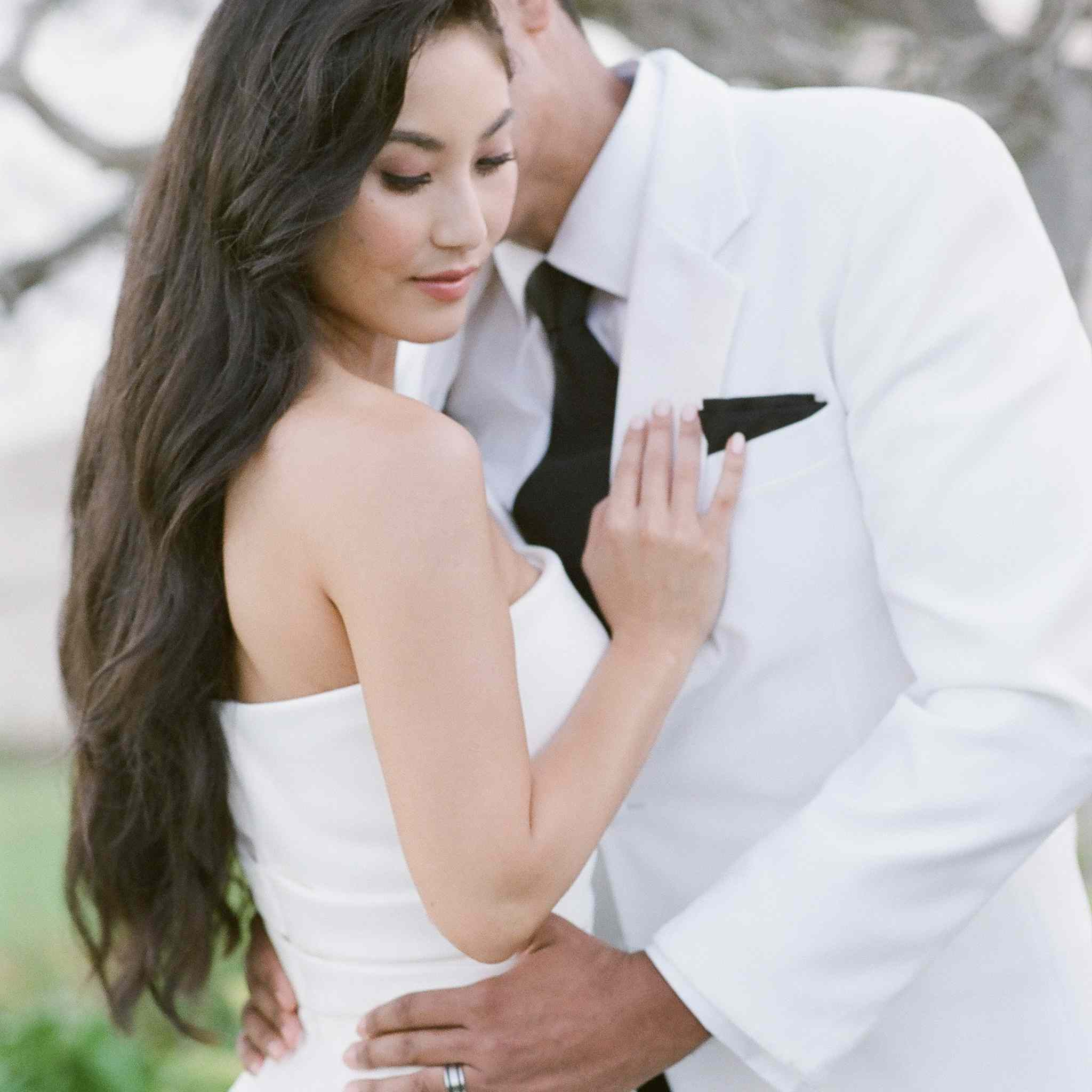 Groom kissing bride with long hair