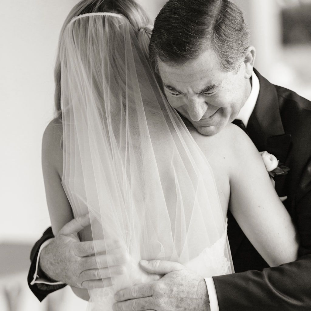 timeless southern wedding, father hugging bride