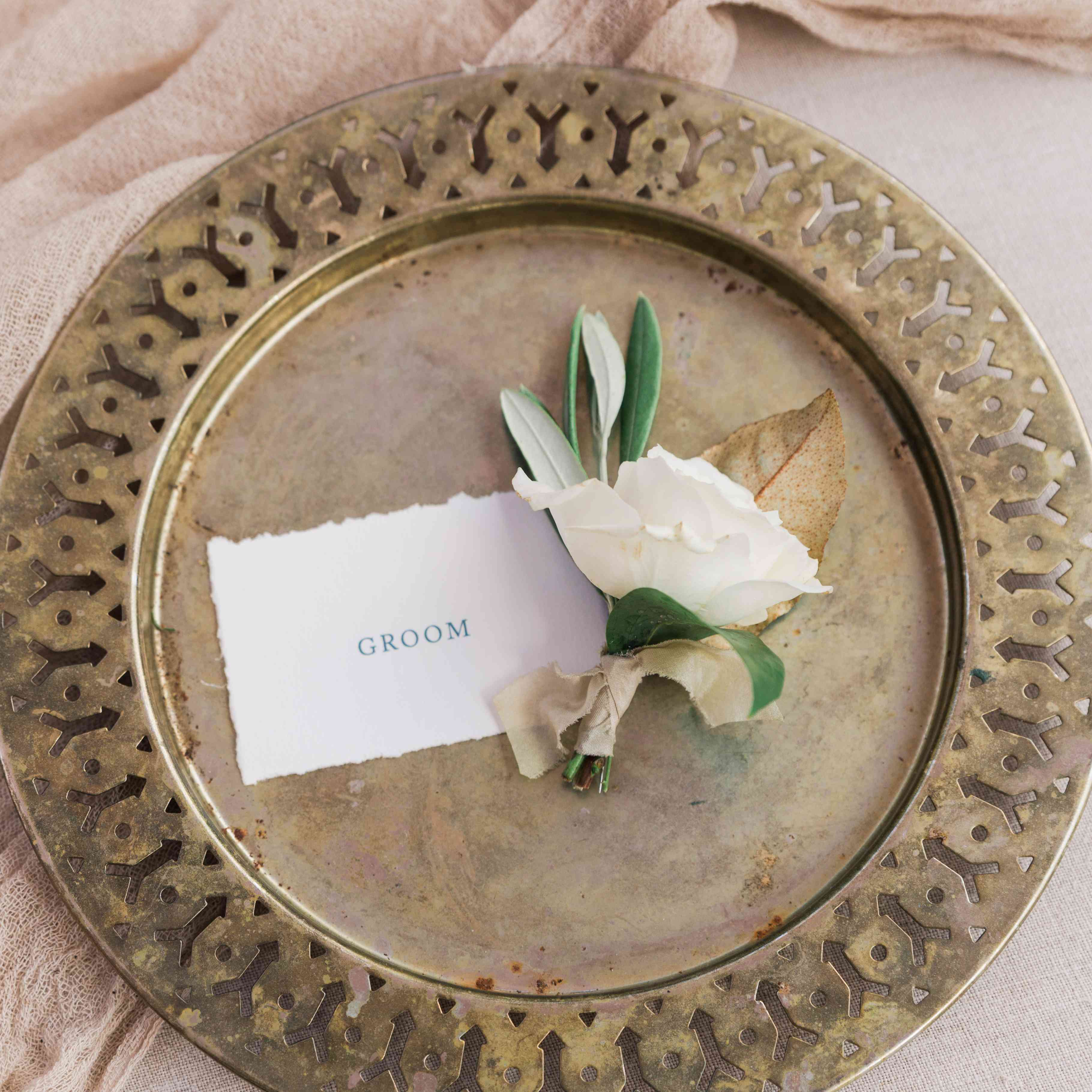 Rose boutonniere with browned leaf