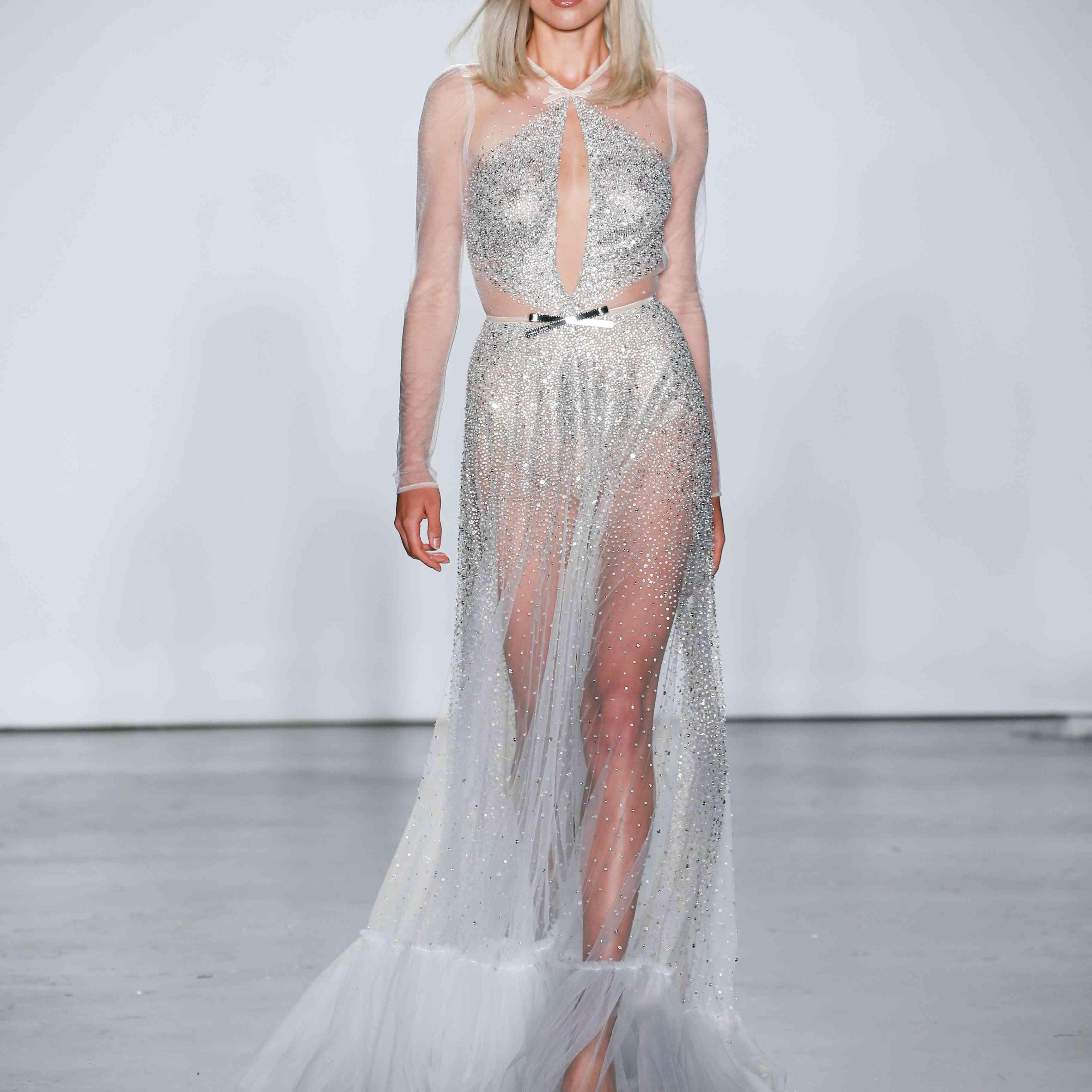 Model in silver keyhole front wedding dress