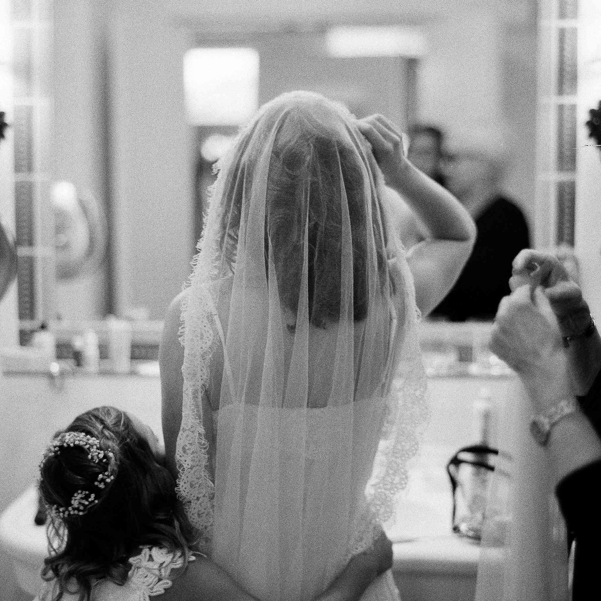 Bride getting ready hugging flower girl