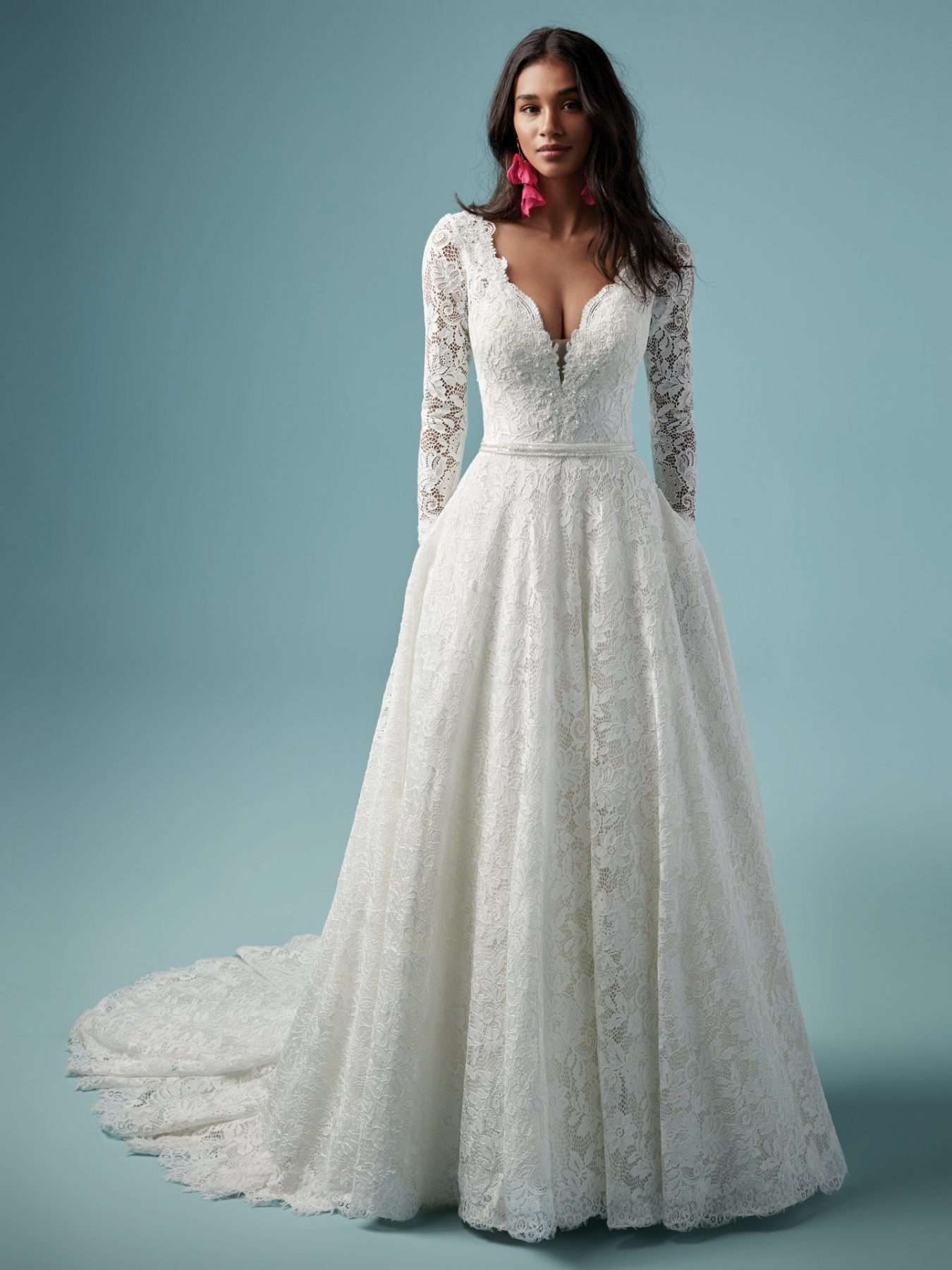 Model in long-sleeve lace wedding gown with pockets