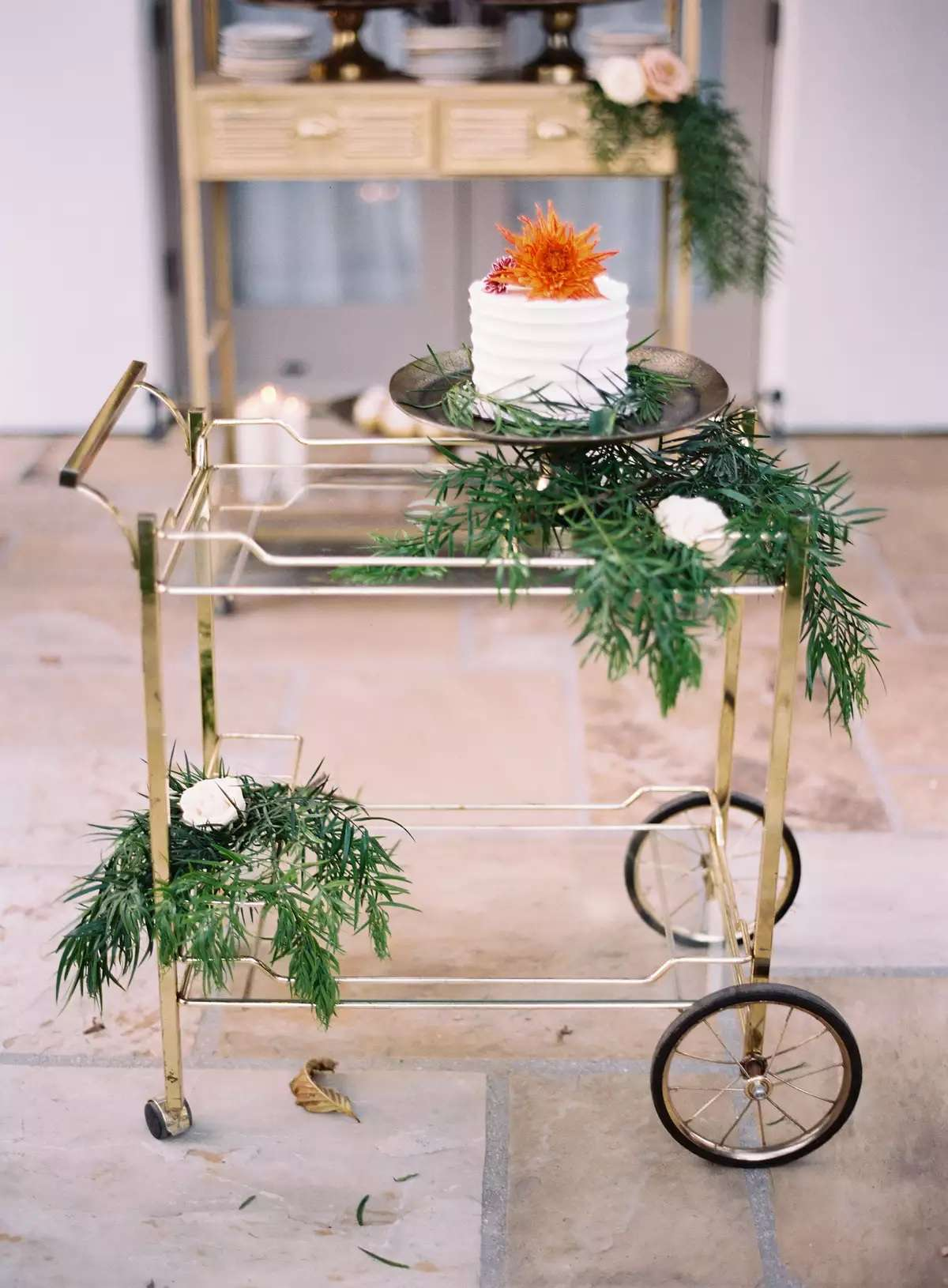 wedding cake on a bar cart