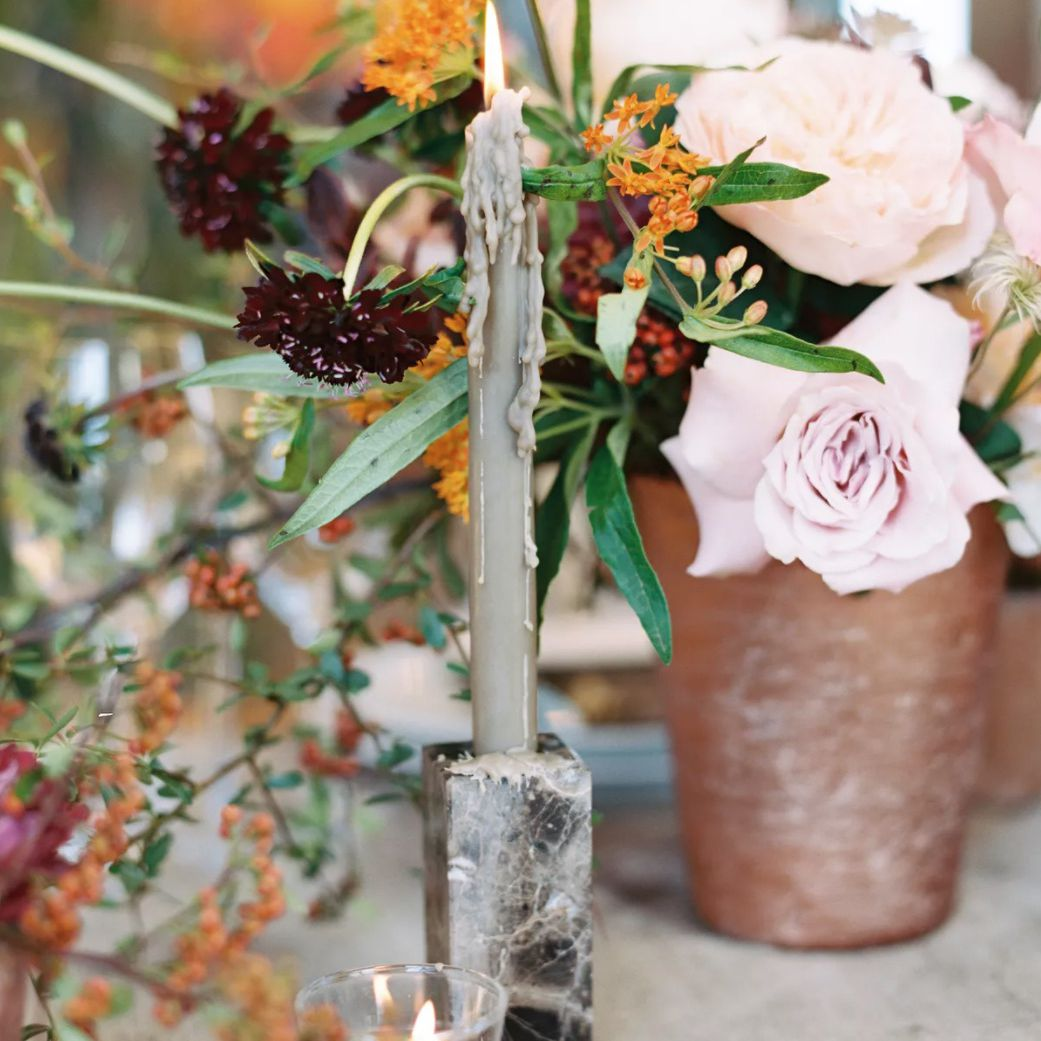 Stone candleholder and terra cotta vases