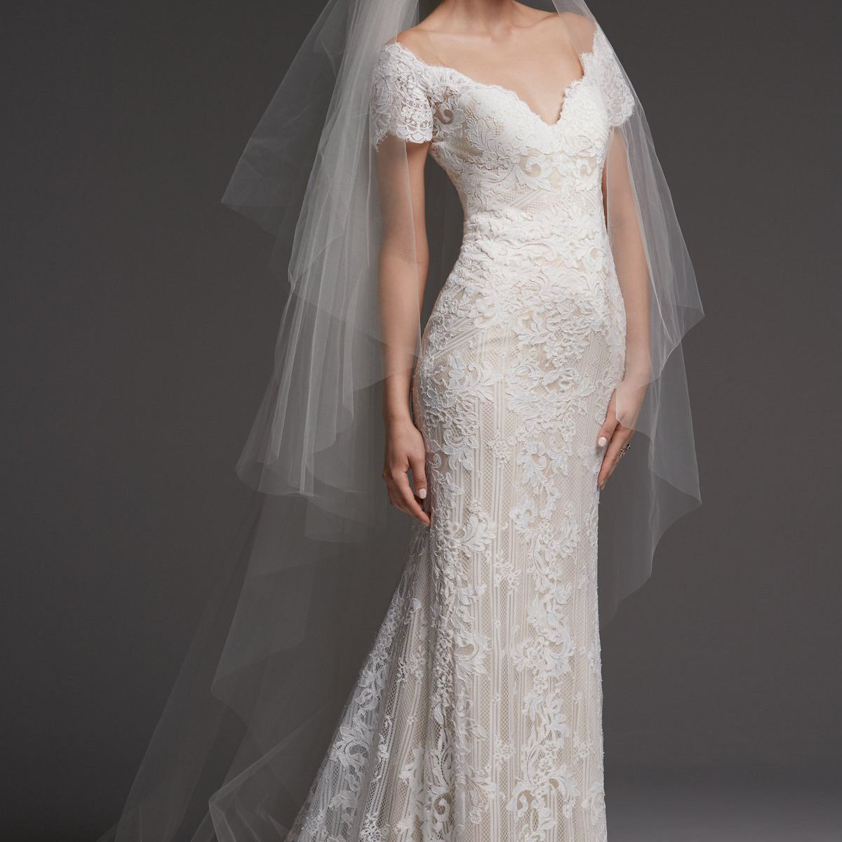 Model in lace off-the-shoulder wedding gown