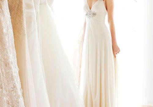 bride in wedding dress at bridal salon