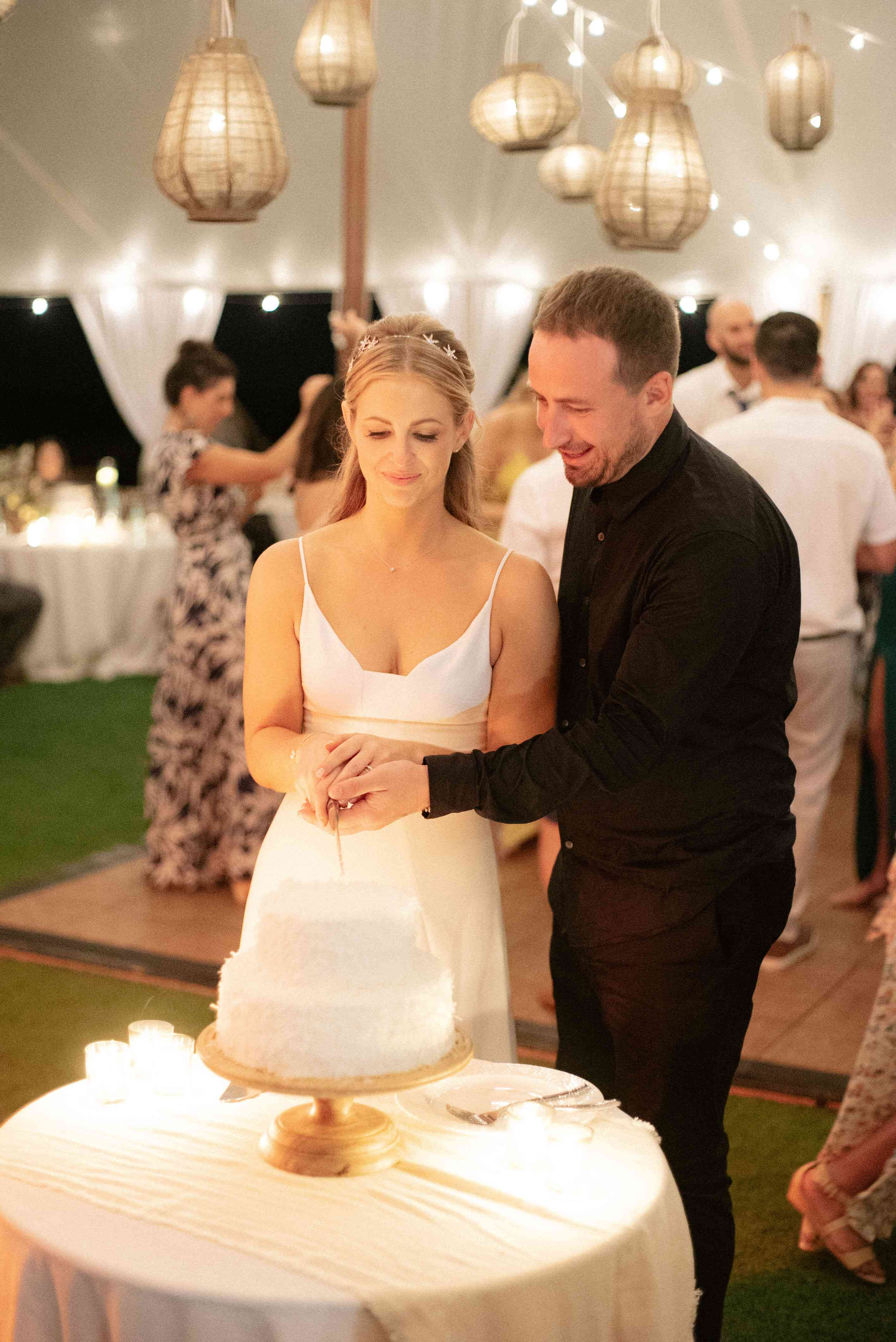 The couple cuts their wedding cake