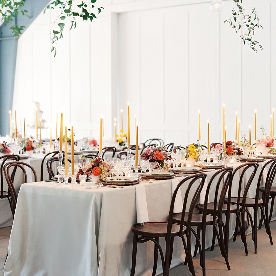 Yellow candles on white tablescape