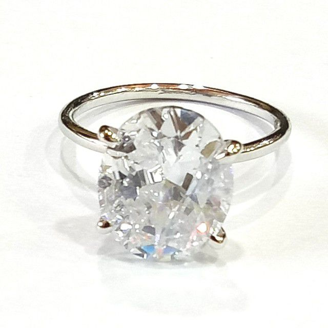 thin band oval ring