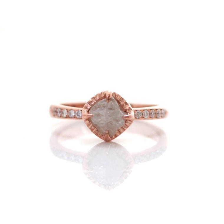 Raw diamond set in a rose gold diamond band