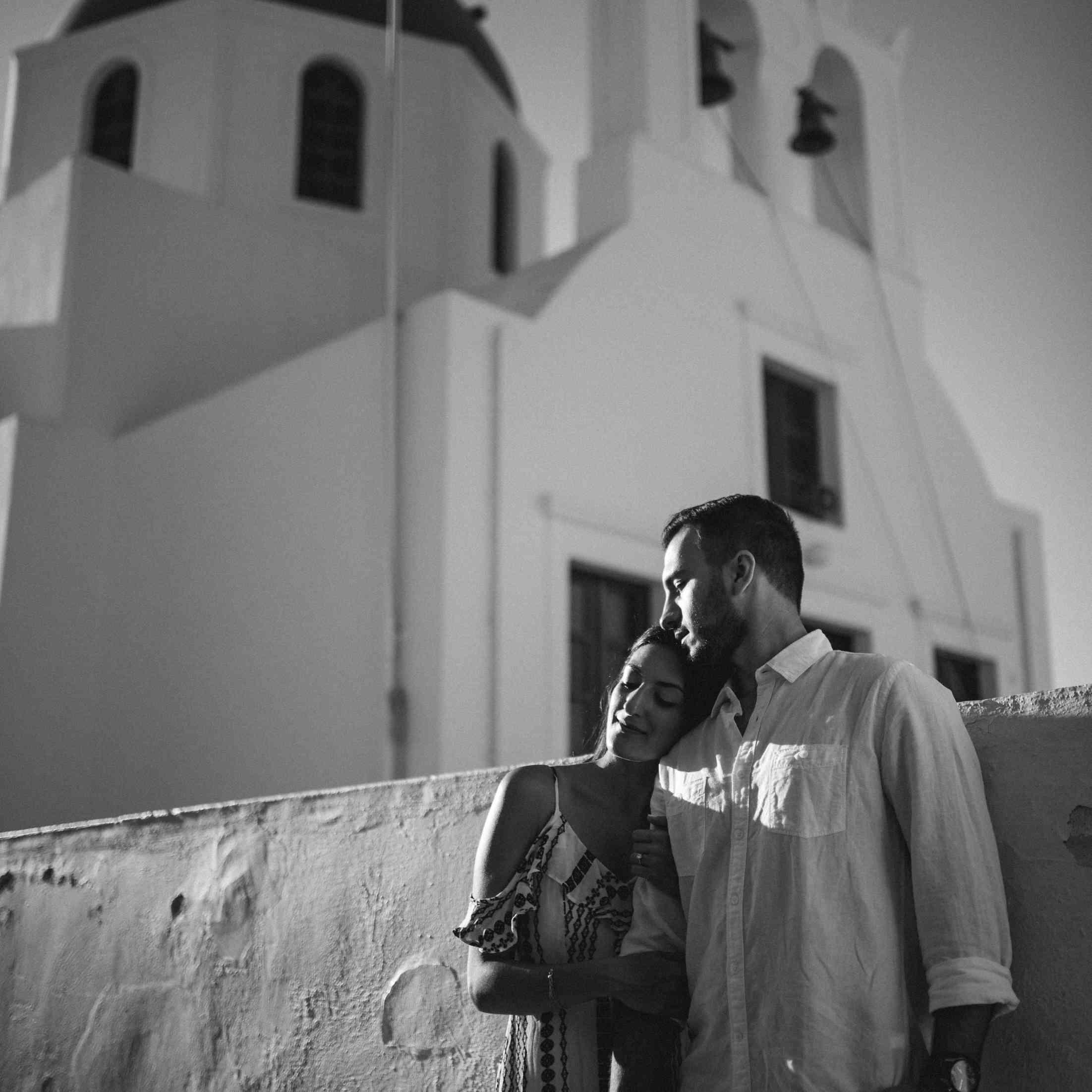 Couple hugging in Santorini Greece