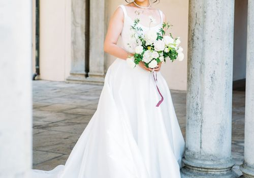 Bride in Reem Acra Wedding Dress Holding White Bouquet