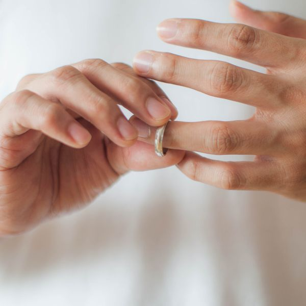 man holding wedding ring