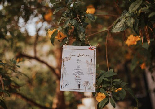 Table assignments hanging from tree