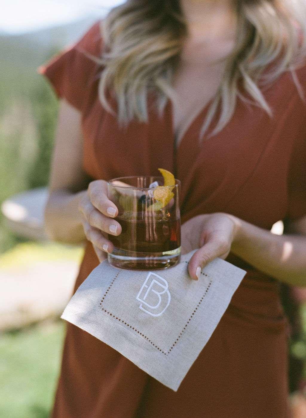 signature cocktail and custom napkin