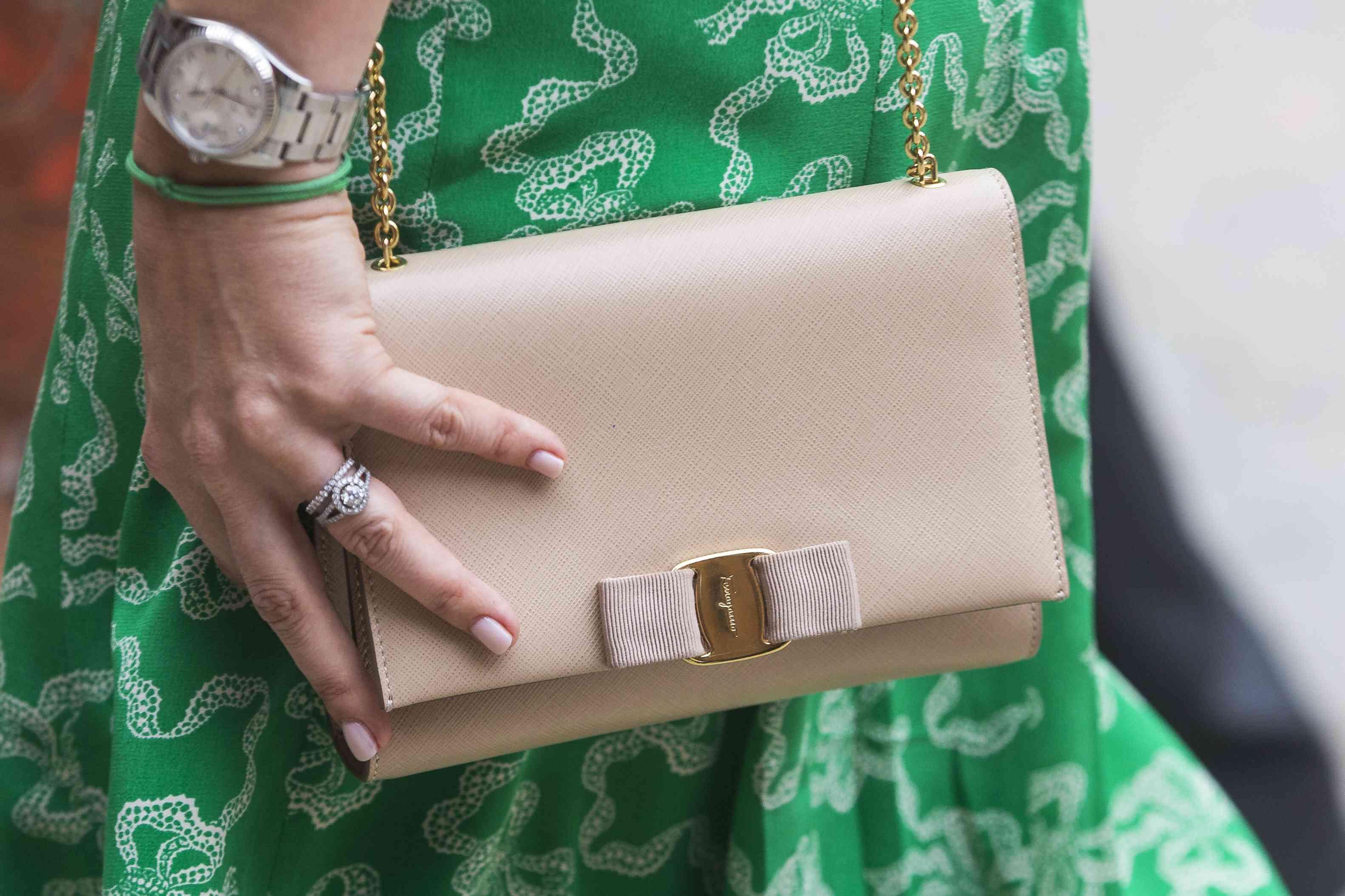 engagement ring and handbag