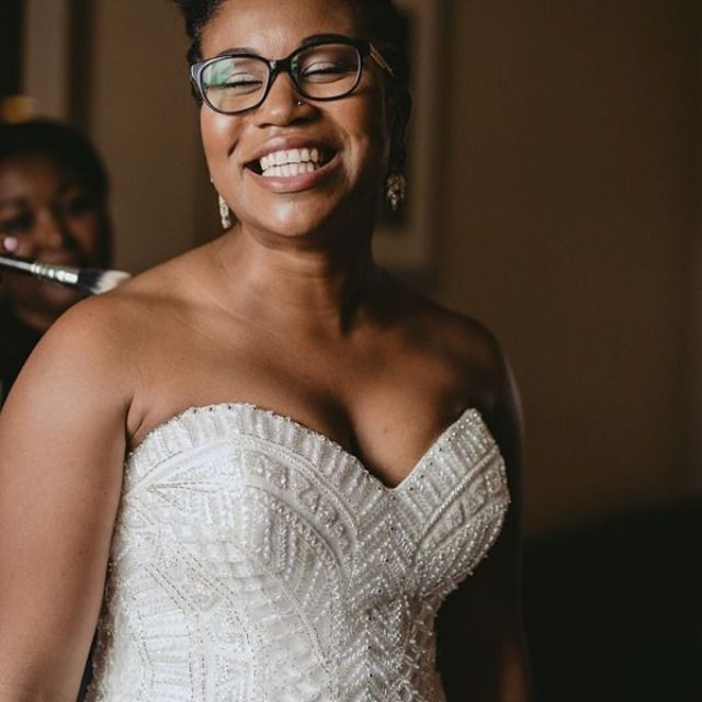 Black bride in glasses and strapless weddinggown