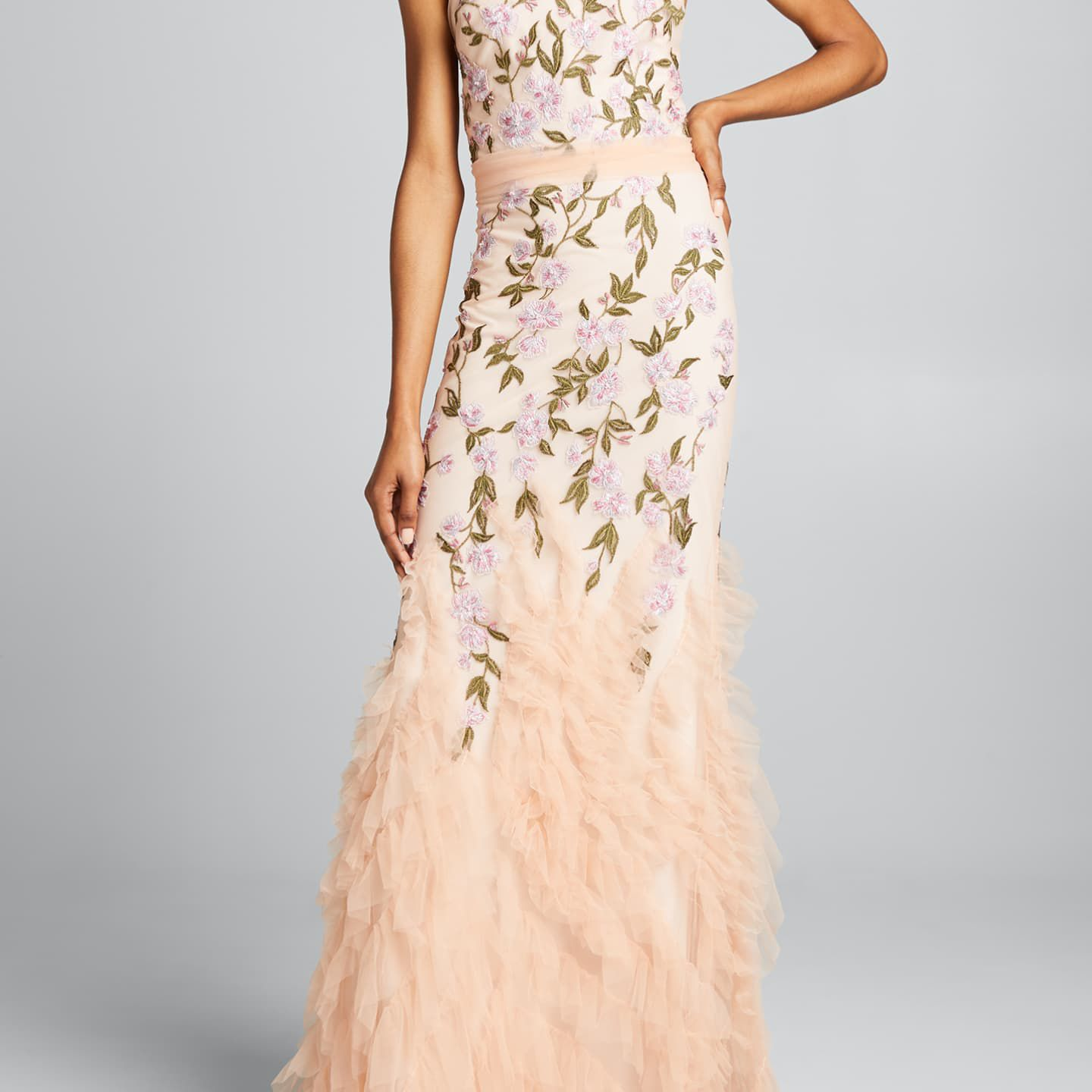 Model in multicolored gown with floral embellishment and feathered tulle skirt