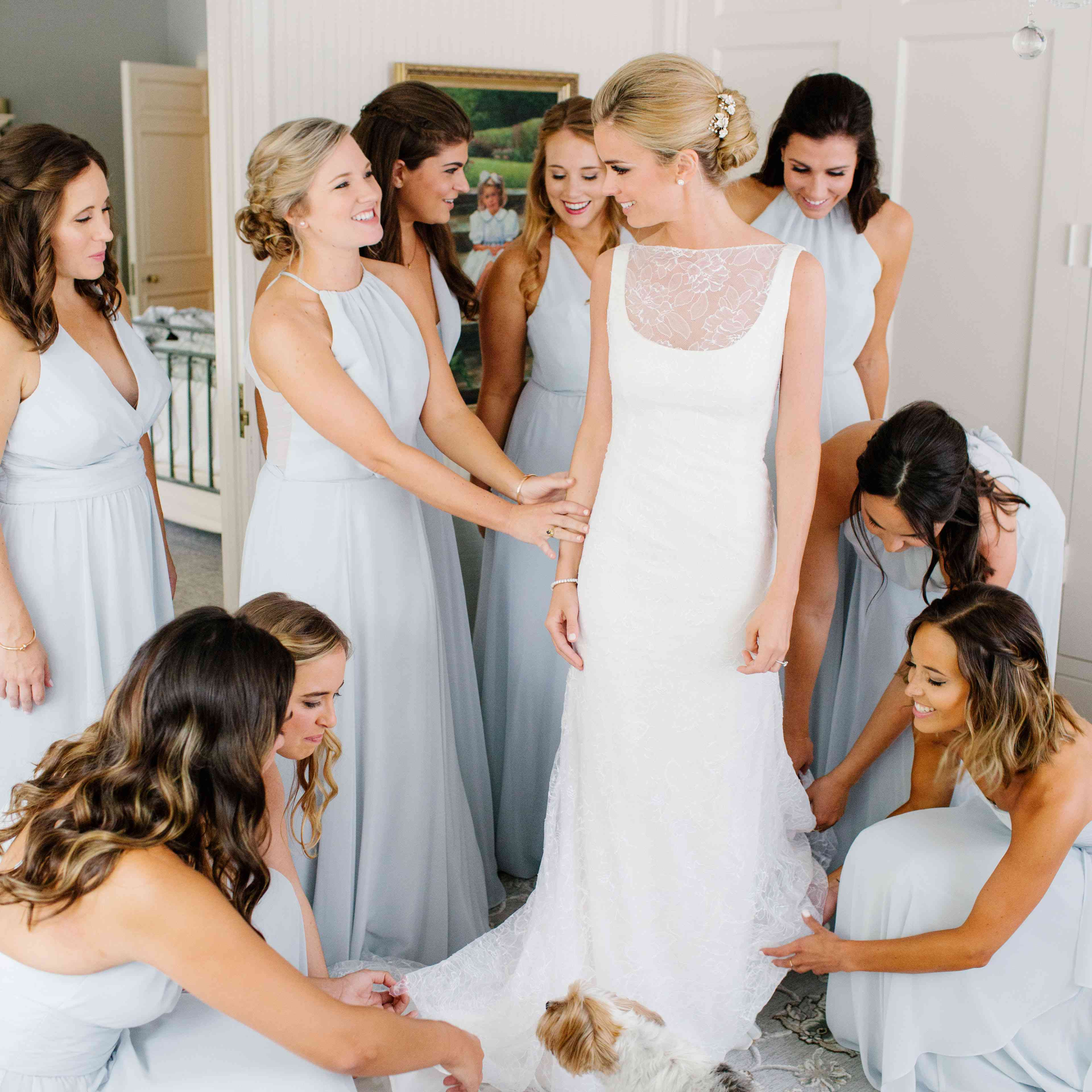 bride with bridesmaids and dog