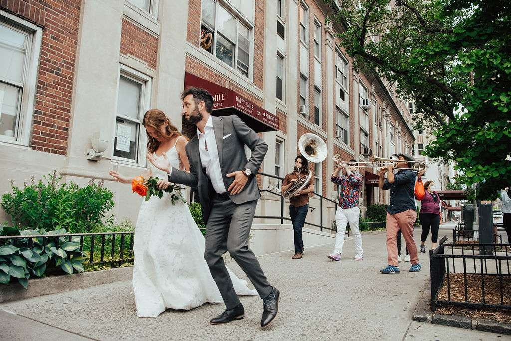 couple dancing with brass band