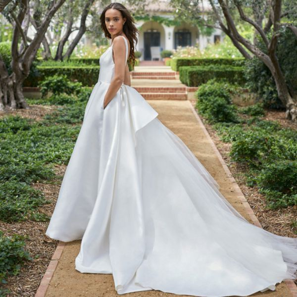 Model in white ball gown wedding dress with pockets