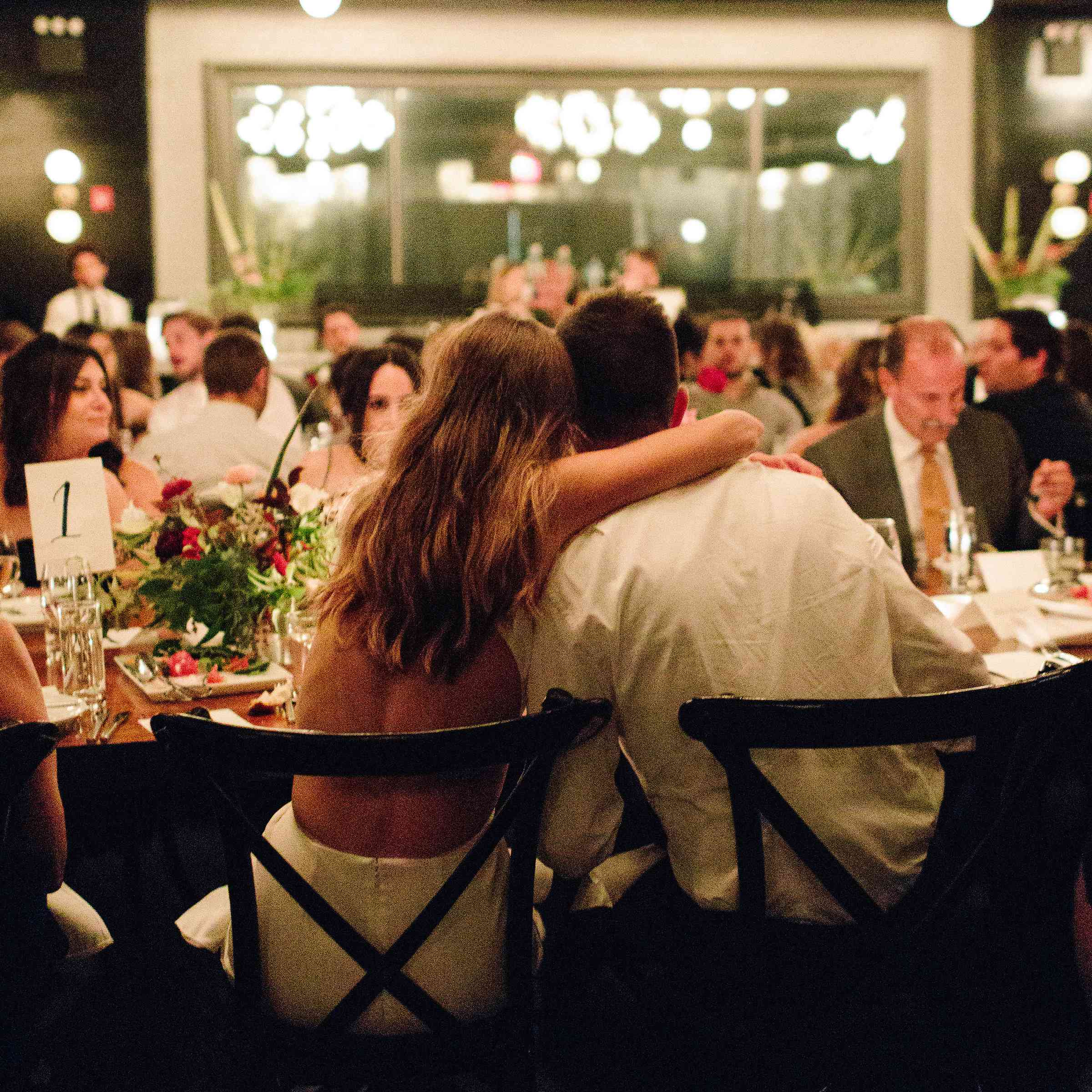 Bride and groom during dinner