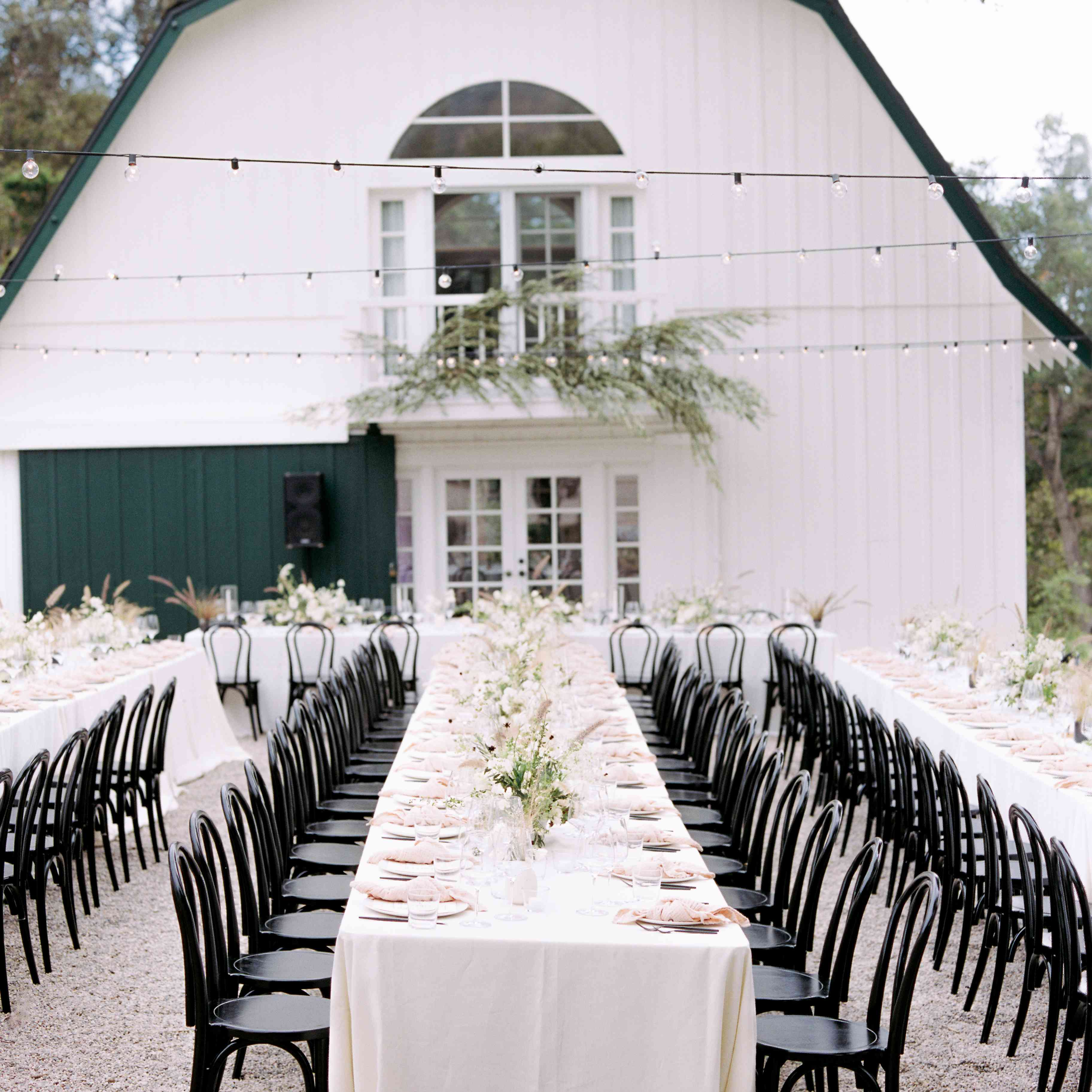 white linens and black chairs