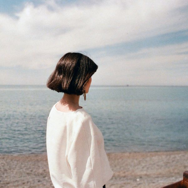 a woman looking out into the ocean