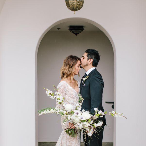 <p>groom kissing bride on forhead</p>