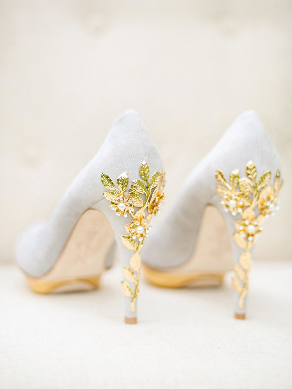 Pale gray shoes with gold-plated heels.