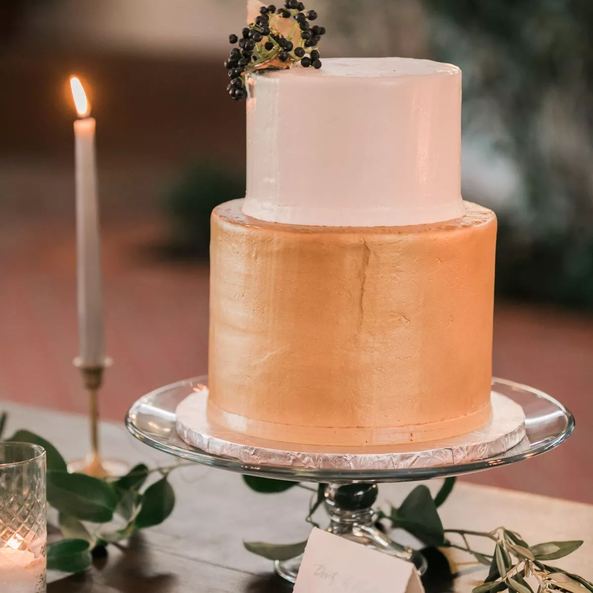 two tiered wedding cake with gold and white