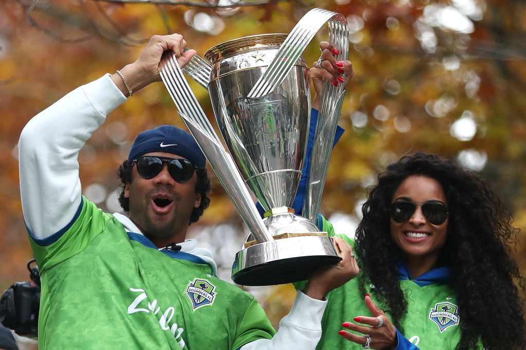 russell wilson and ciara holding trophy