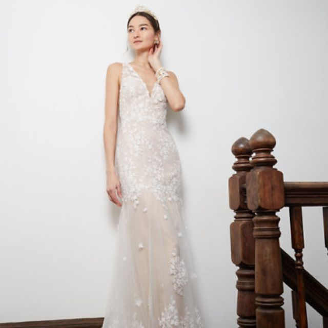 Model in sheer floral lace gown