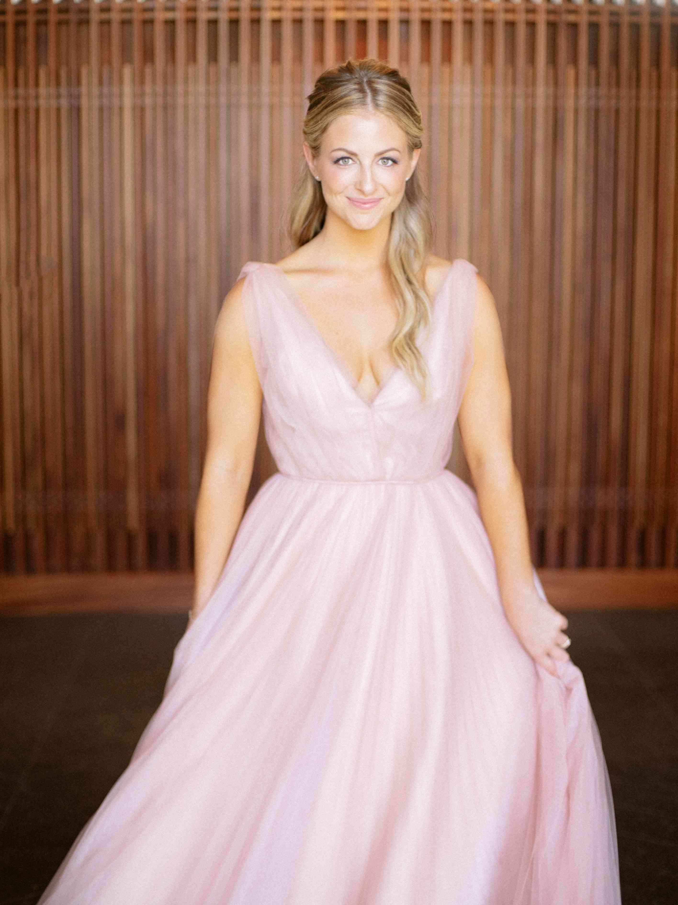 The bride in her pink Naeem Khan gown
