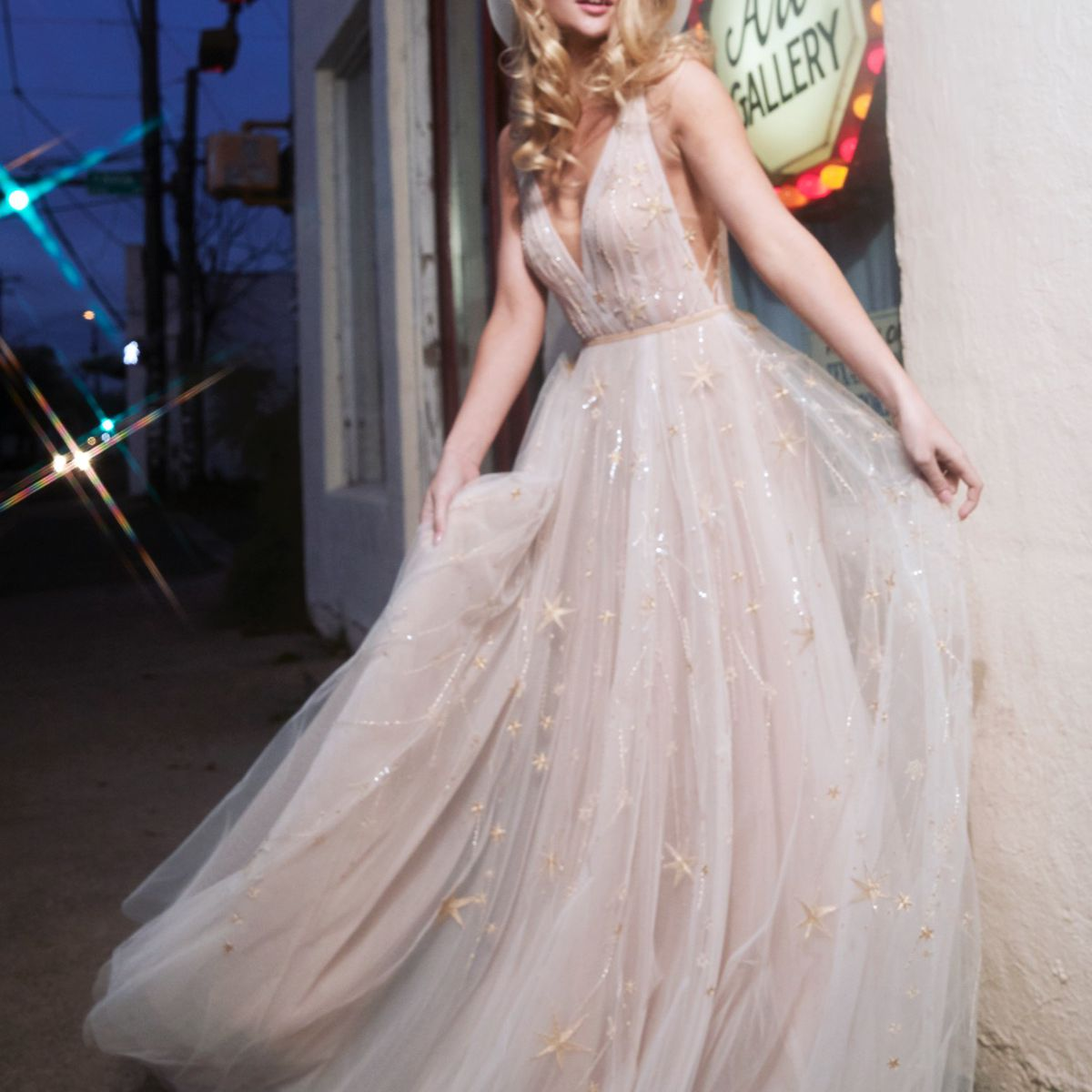 Model in V-neck tulle ballgown with shooting star embroidery and beading