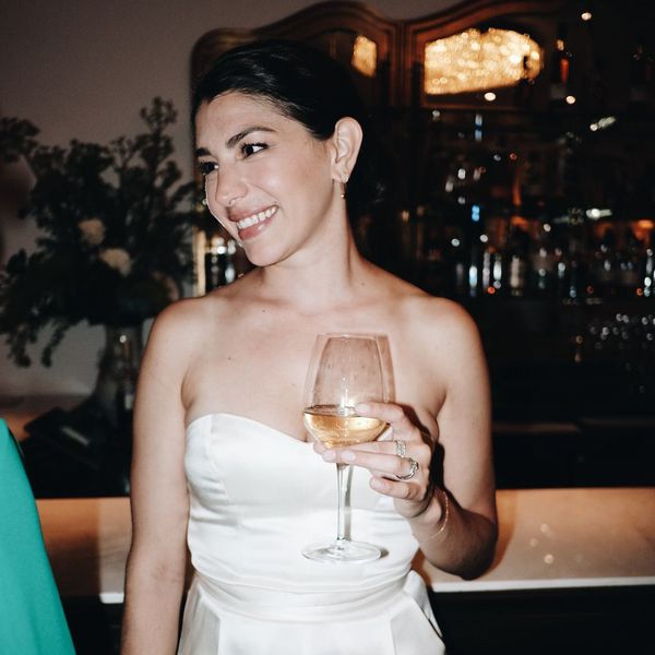 bride holding glass of wine