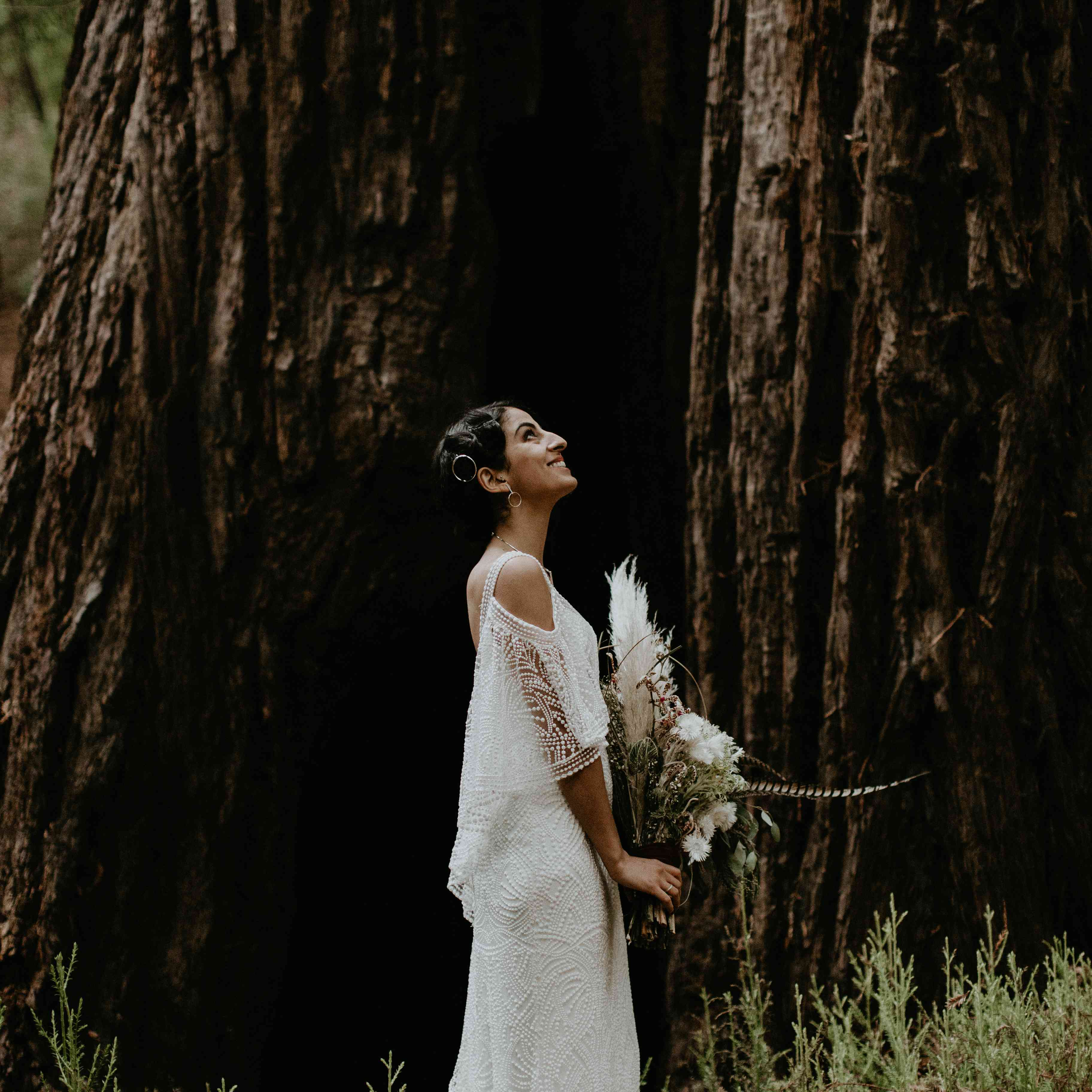 <p>bride with wildflower bouquet in forest elopement</p><br><br>