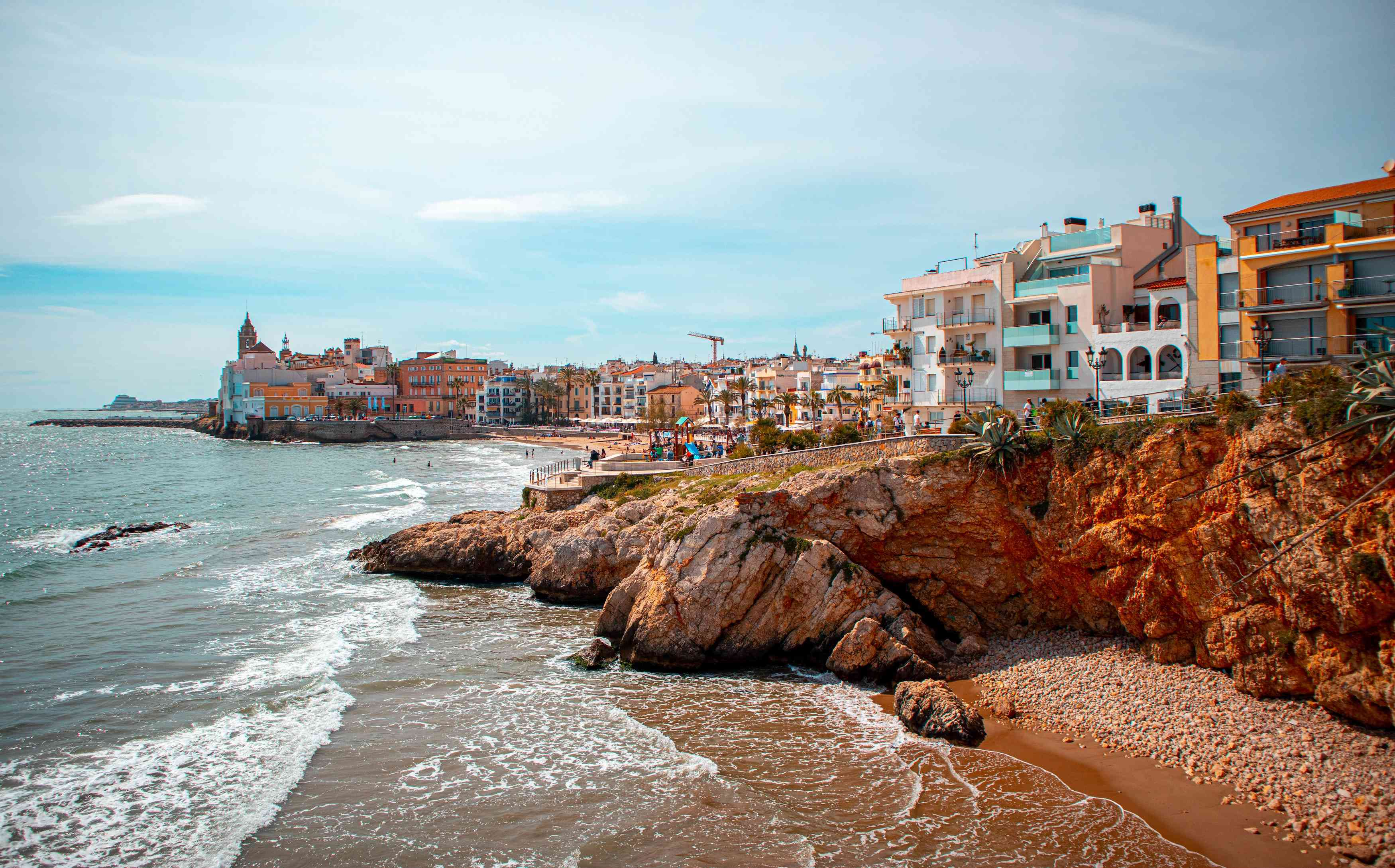 The coast and colorful buildings of Sitges, Spain