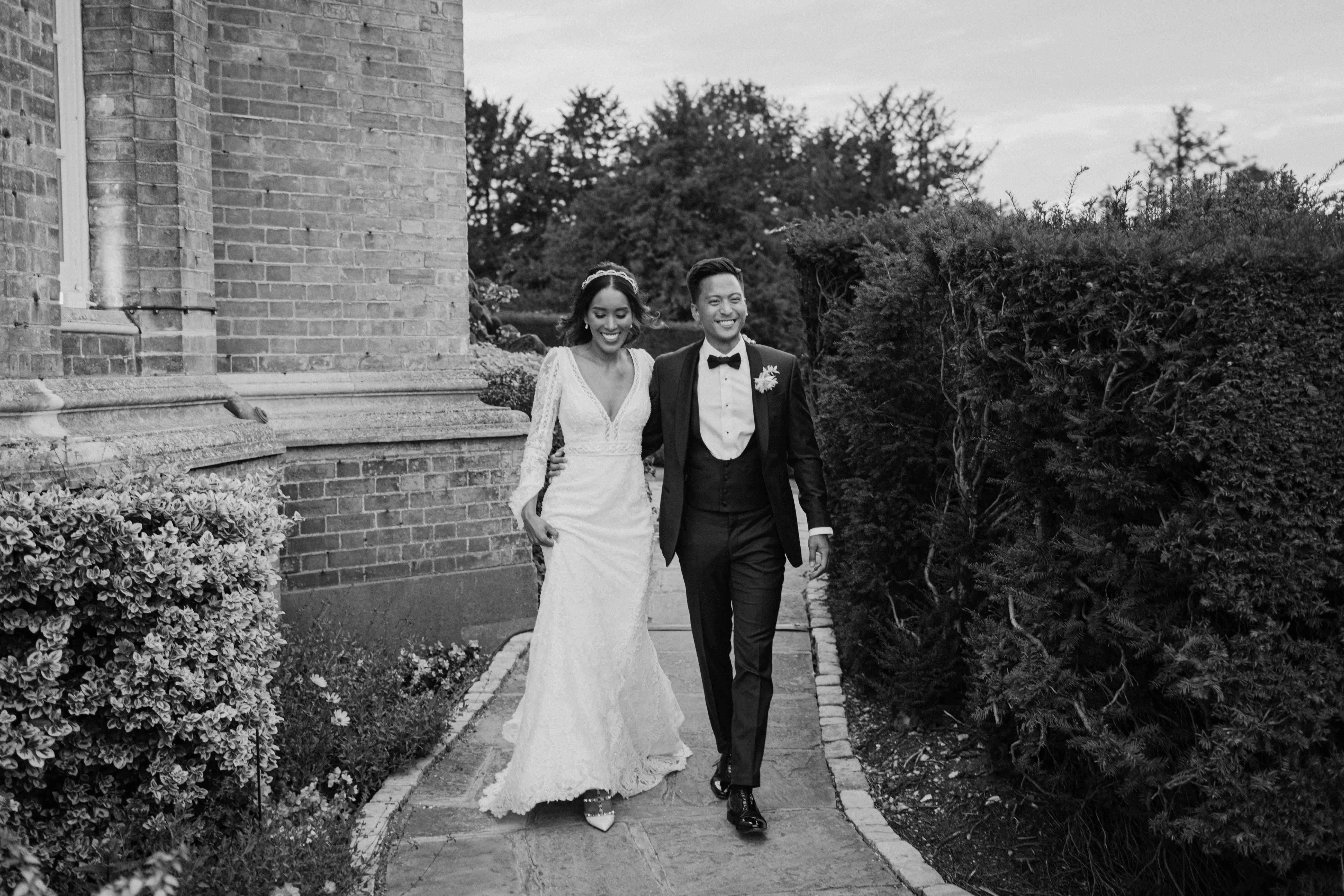 The bride and groom take a walk