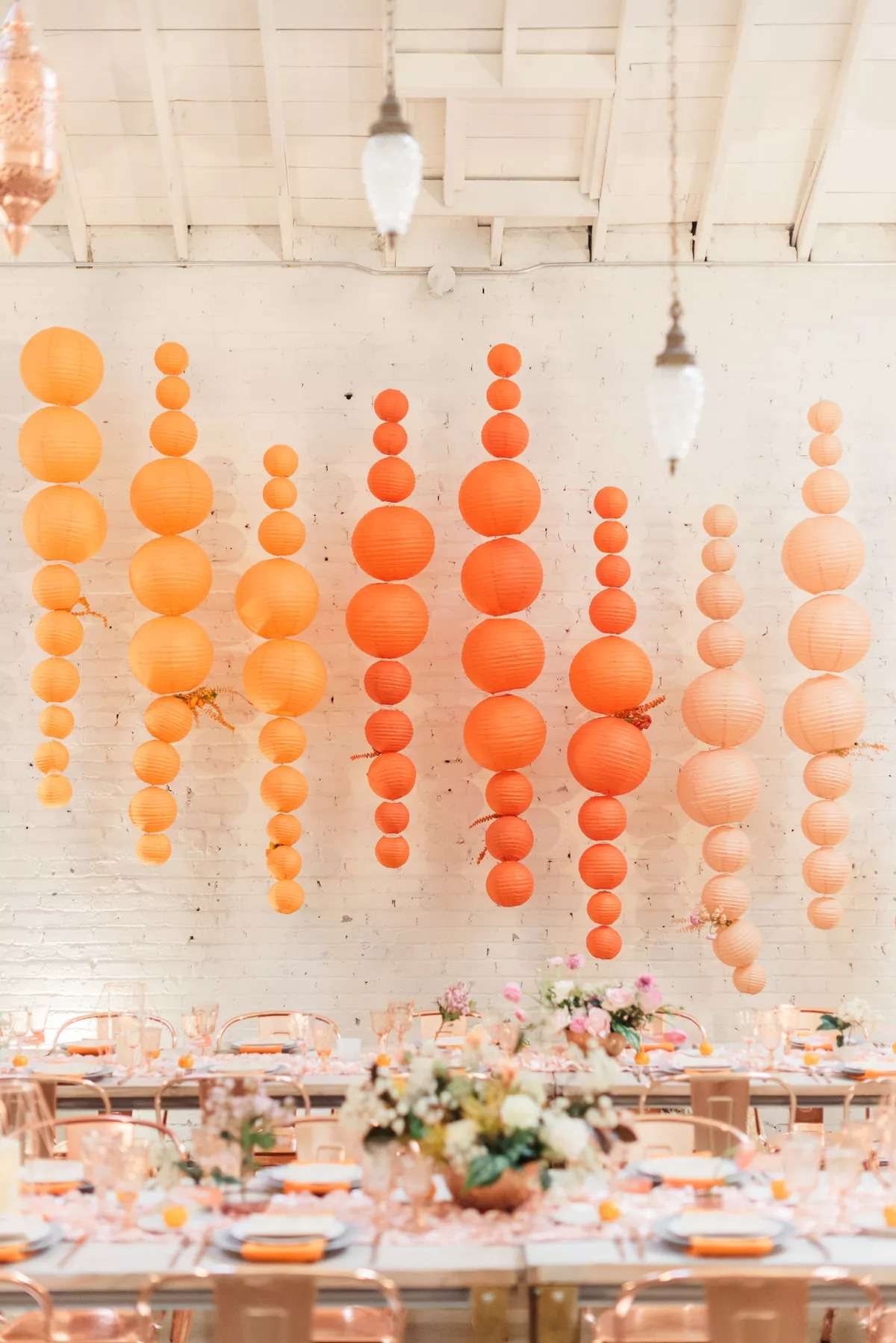Orange ombre balloon garlands hanging on a wall