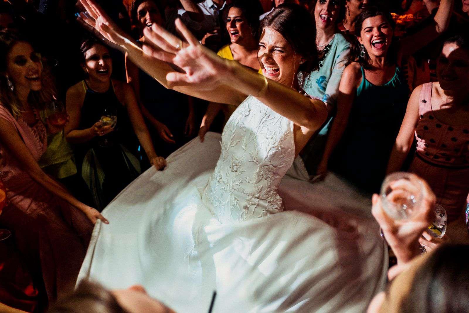 Brazilian bride dancing with friends