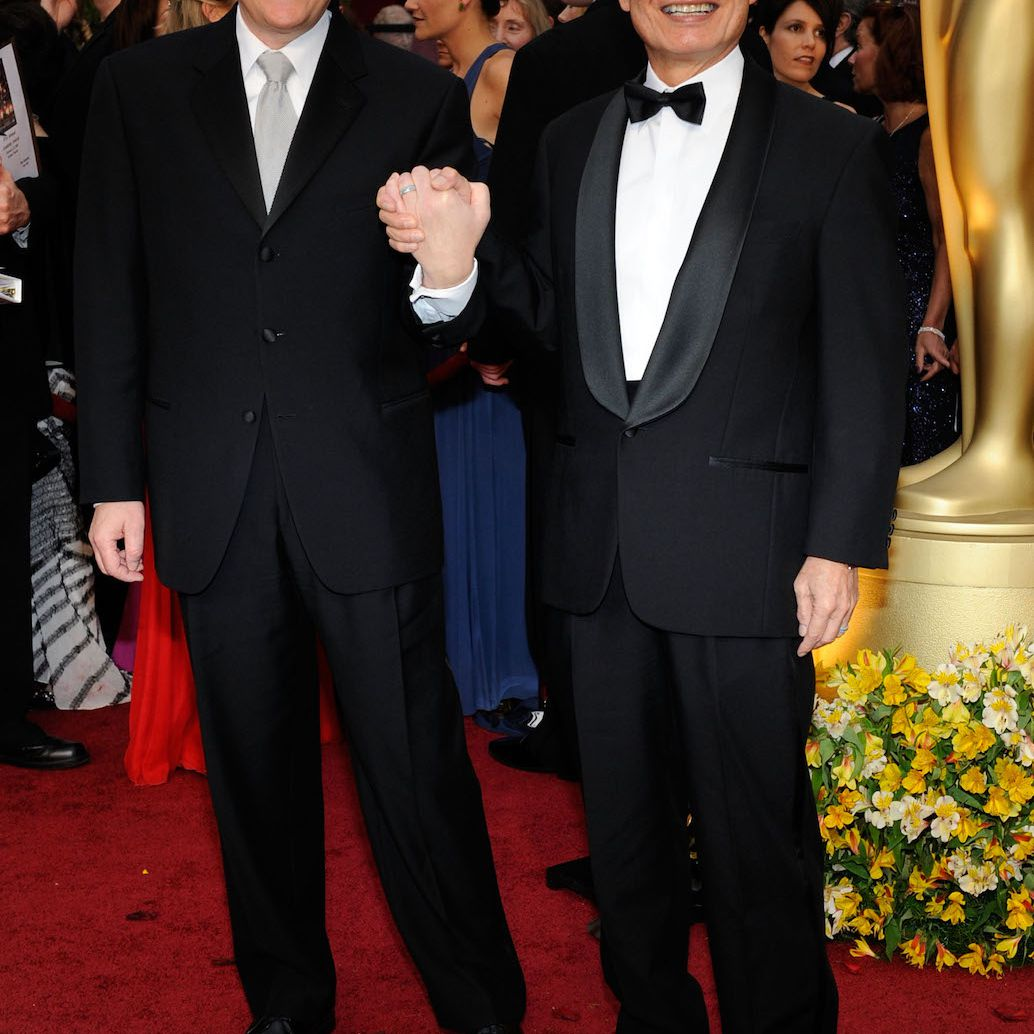 Brad Takei and George Takei clasp hands on the red carpet