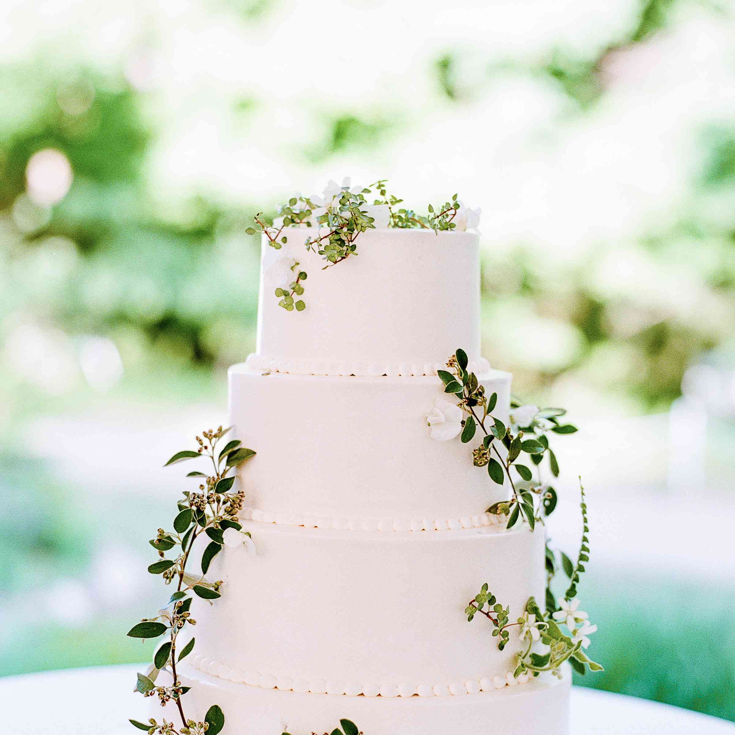 Wedding cake with sprigs of leaves